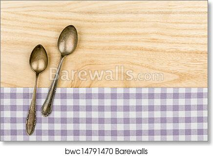Art Print Of Two Silver Spoons On A Purple Checkered Table Cloth On A  Wooden Background