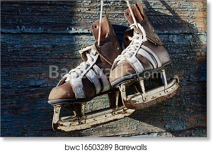 Vintage Pair Of Mens Ice Skates Hanging On A Wooden Wall With C Art Print Poster