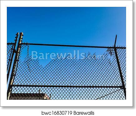 art print of old broken cyclone fence against blue sky barewalls