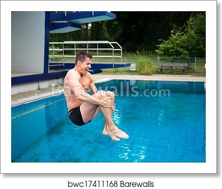 Man having fun jumping from diving board at swimming pool art print poster