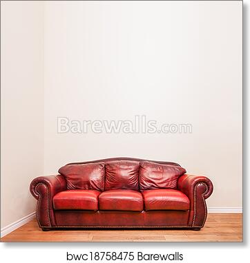 Luxurious Red Leather Couch in front of a blank wall art print poster