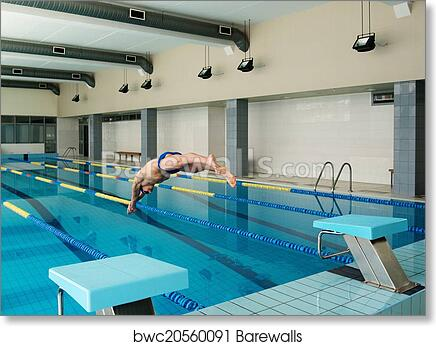 Young muscular swimmer jumping from starting block in a swimming pool art  print poster