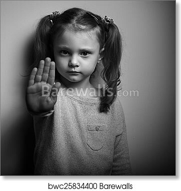 Stop violence against kids serious kid showing hand stop sign black and white portrait