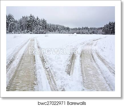A pair of Snowmobile tracks on the frozen lake art print poster