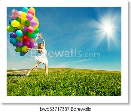 Happy Birthday Woman Against The Sky With Rainbow Colored Air Balloons In Her Hands Sunny And Positive Energy Of Nature Young Beautiful Girl On Grass