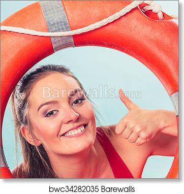 84c0dbd765f4 Lifeguard woman on duty with ring buoy lifebuoy