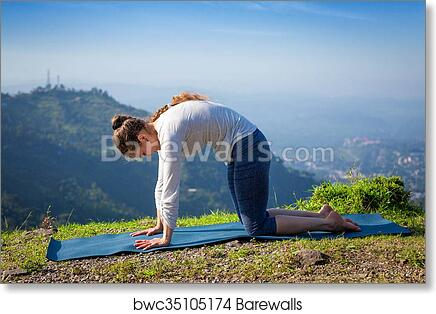 Art Print Of Woman Practices Yoga Asana Marjariasana Outdoors