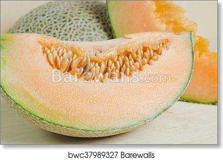 art print of sliced melon with seed on wooden board other names are