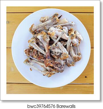 Art Print Of Chicken Bones In White Plate On Wooden Table Food