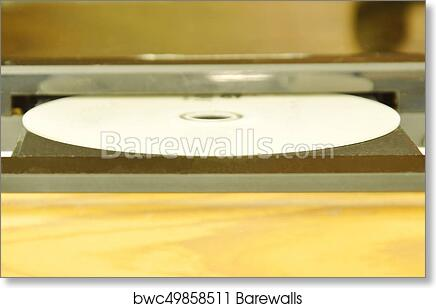 art print of dvd put on insert disc player in wooden cupboard