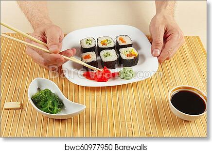 Hands Taking Ginger With Chopsticks Assorted Sushi Hiyashi Wakame Salad And Soy Sauce On A Bamboo Mat Art Print Poster