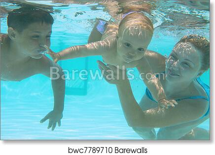 Underwater family in swimming pool. Mother teaching her kids art print  poster