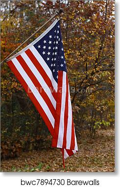 art print of a vertical hanging american flag outside against a fall