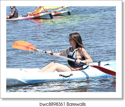 art print of woman on a kayaking excursion barewalls posters