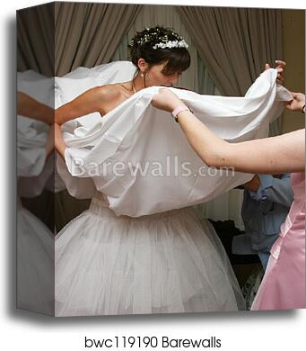 Canvas Print Of Bride Getting Dressed