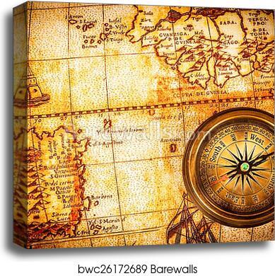 Vintage compass lies on an ancient world map. canvas print