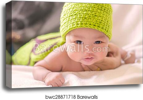 4b5640624 Portrait of cute newborn baby girl on the bed, Canvas Print | Barewalls  Posters & Prints | bwc28871718