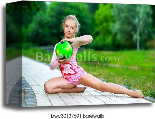 canvas print of outdoor portrait of young cute little girl gymnast