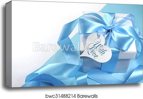 Beautiful Pale Aqua Baby Blue Gift With Love Heart Shape Tag On And White Background Copy Space For Fathers Day Boy Shower Or