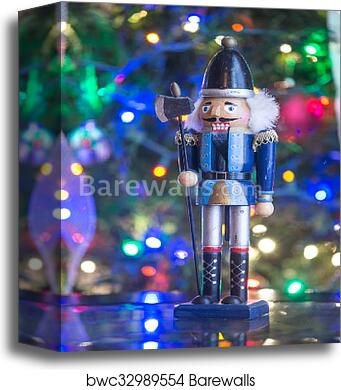 canvas print of soldier nutcracker statue standing in front of decorated christmas tree