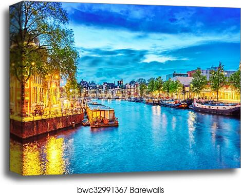 Famous Amstel river and night view of beautiful Amsterdam city  Netherlands  canvas print