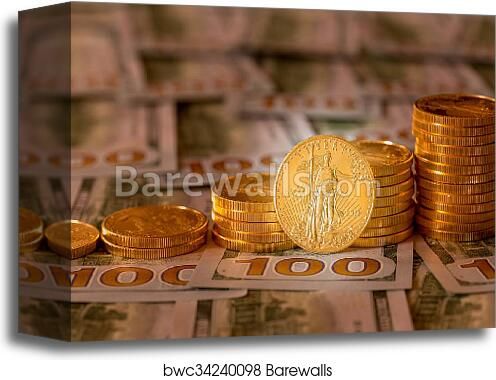 Canvas Print Of Gold Coins Stacked On New Design 100 Dollar Bills