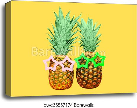 5b20080adb86 Two pineapple with sunglasses on yellow background, colorful ananas, Canvas  Print