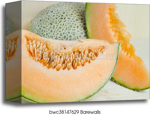 Canvas Print Of Sliced Melon With Seed On Wooden Board Other Names