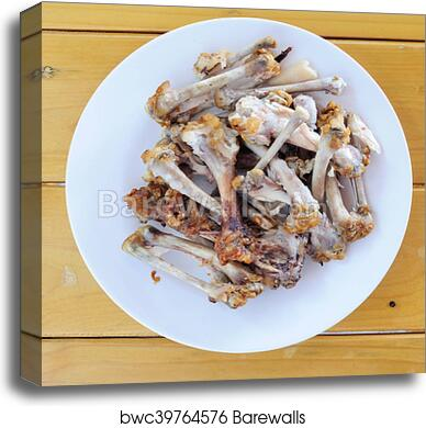 Chicken Bones In White Plate On Wooden Table Food Scraps Canvas