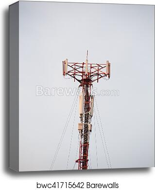 Cell site, Telecommunications radio tower or mobile phone base station with  atop the antennas isolated with white sky background  canvas print