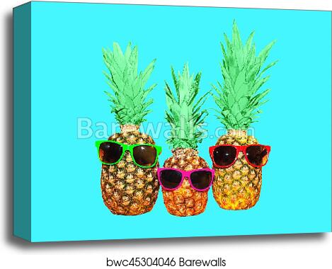 67c3b8fca279 Three pineapple with sunglasses on blue background, colorful ananas photo, Canvas  Print