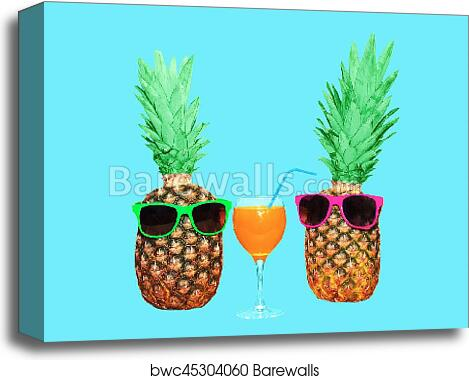 be1ccd22dd3d Two pineapple with sunglasses and glass fruit juice on blue background,  colorful ananas, Canvas Print