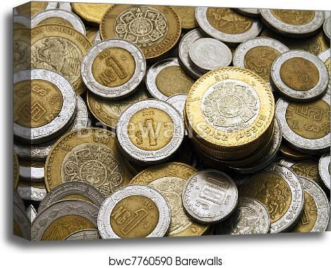 Ten Mexican Pesos Coin on a Pile of Coins canvas print