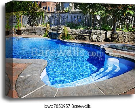 Swimming pool with waterfall canvas print