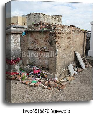 The tomb of unknown Voodoo practitioner, St  Louis Cemetery #1, New  Orleans, Louisiana with a Voodoo doll in the upper left corner and tributes  along