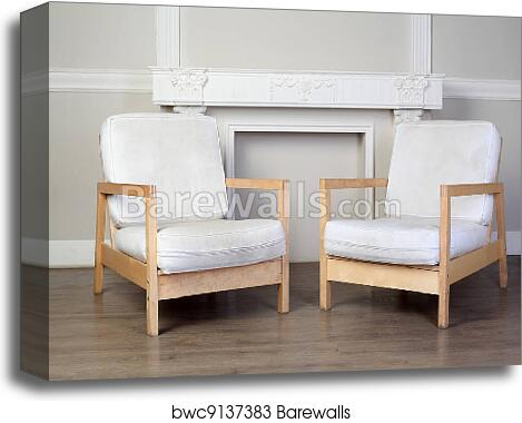 Two white chairs and beautiful ornate decorative plaster moldings on wall  canvas print